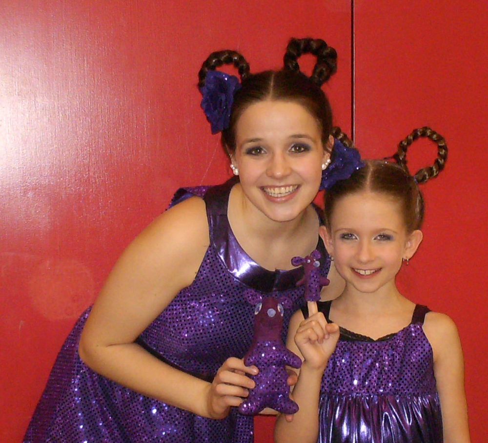 Kelly and Paige who played the sour kangaroos in Seussical the Musical holding the custom made purple kangaroo ad finger puppet