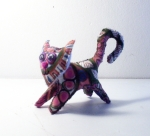 Small cat sewn from painted, recycled felt and denim by Amy Lyn Kench